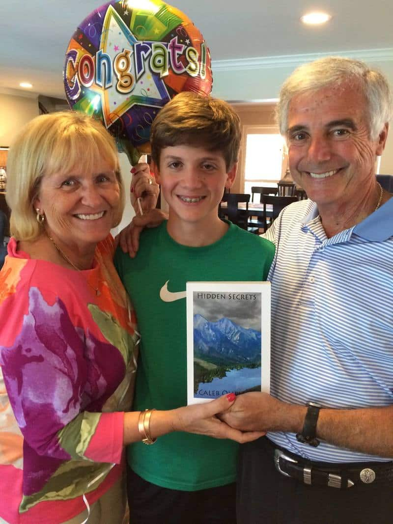 My nephew with his self-published book, flanked by proud grandparents!